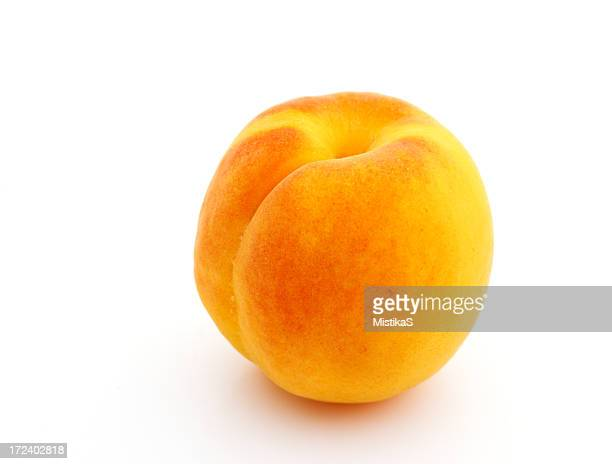 An isolated ripe apricot on white