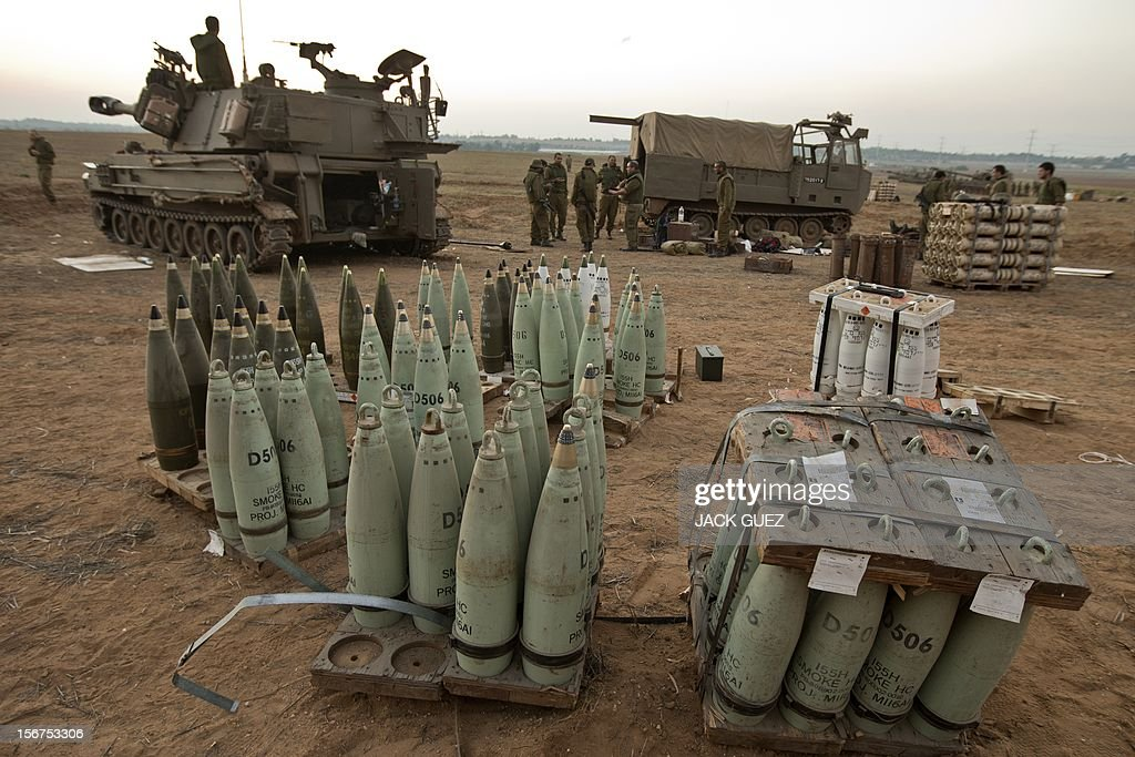 An Israeli 155mm artillery canon and artillery shells are seen as troops are stationed on November 20, 2012 on the Israel-Gaza border. A ceasefire to end almost a week of violence in and around the Gaza Strip is to be announced in Cairo, Hamas and Islamic Jihad sources told AFP.