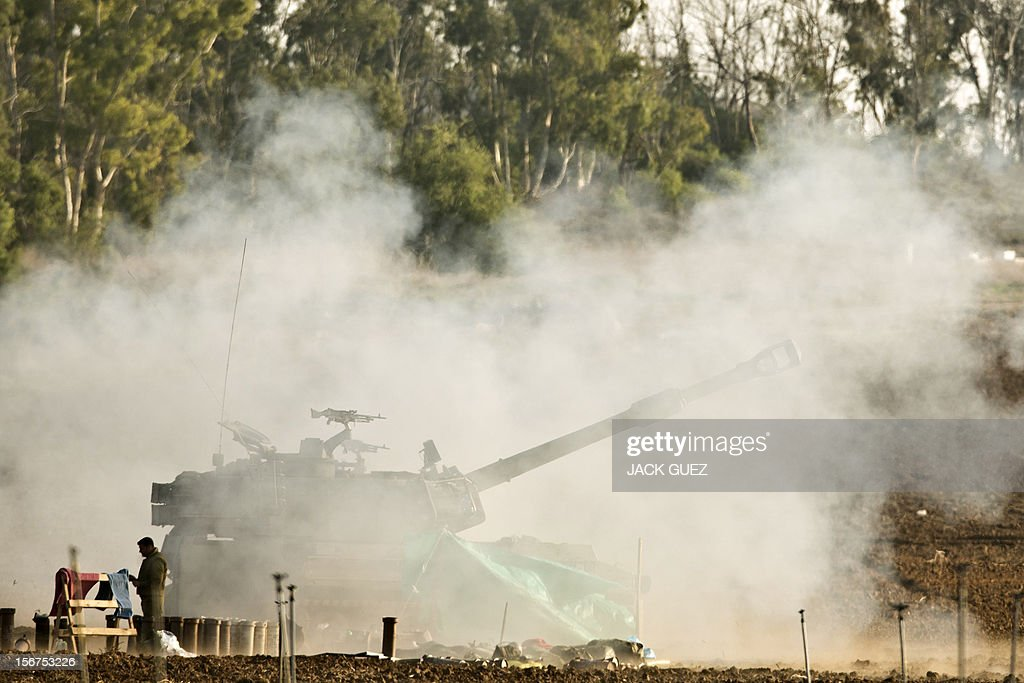 An Israeli 155mm artillery canon fires a shell from the Israel-Gaza Strip border into the Gaza Strip, on November 20, 2012. A ceasefire to end almost a week of violence in and around the Gaza Strip is to be announced in Cairo, Hamas and Islamic Jihad sources told AFP. AFP PHOTO/JACK GUEZ