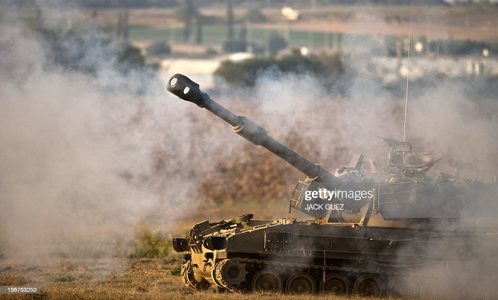 An Israeli 155mm artillery canon fires a shell from the Israel-Gaza Strip border into the Gaza Strip, on November 20, 2012. A ceasefire to end almost a week of violence in and around the Gaza Strip is to be announced in Cairo, Hamas and Islamic Jihad sources told AFP.