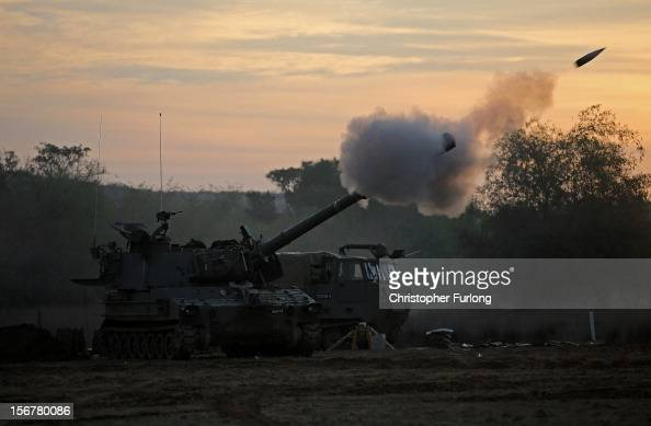 An Israeli 155mm artillery gun fires a shell from an emplacement on Israel's border into the Gaza Strip on November 21 2012 on Israel's border with...
