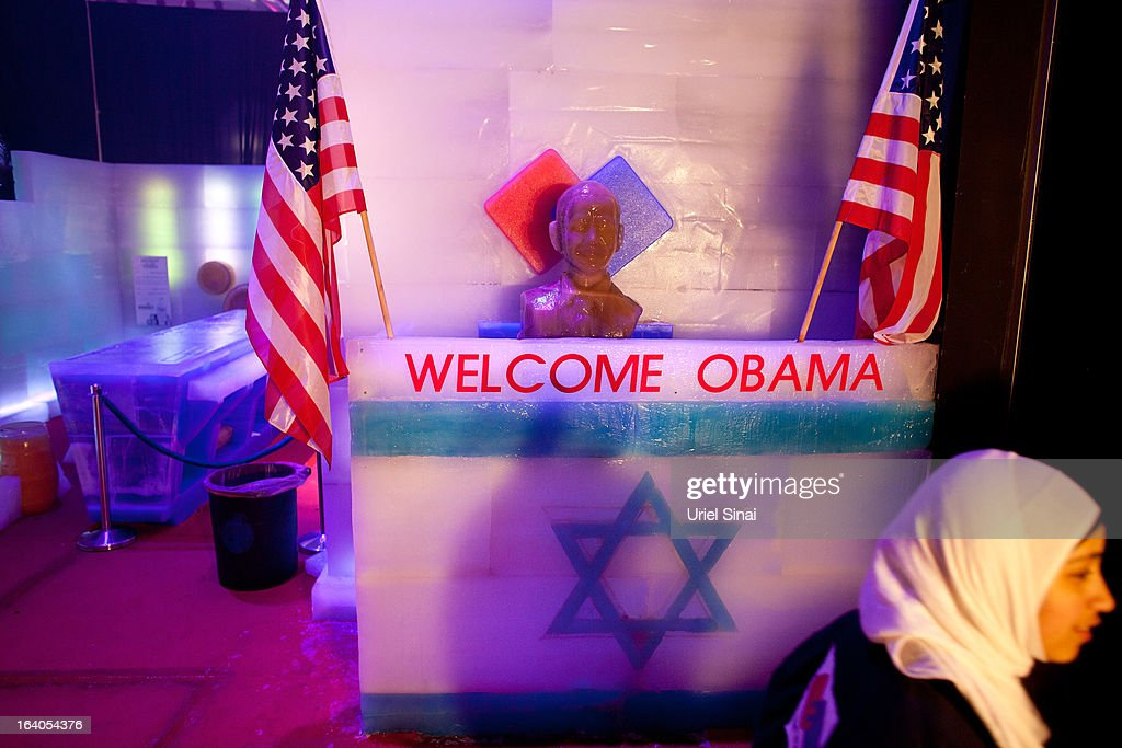 An Israeli Arab school girl walks by an ice statue of US President <a gi-track='captionPersonalityLinkClicked' href=/galleries/search?phrase=Barack+Obama&family=editorial&specificpeople=203260 ng-click='$event.stopPropagation()'>Barack Obama</a>, which was installed ahead of the upcoming visit by the US president, at the 'Ice Festival' showroom on March 19, 2013 in Jerusalem, Israel. Obama will make his first visit as President to the region tomorrow, and his itinerary will include meetings with the Palestinian and Israeli leaders as well as a visit to the Church of the Nativity in Bethlehem.