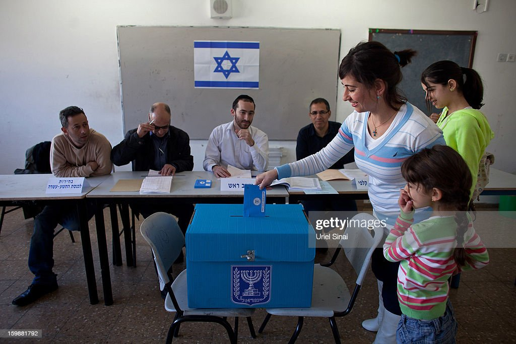 An Israeli Arab woman and her children casts their vote at a polling station during the Israeli General Election on January 22, 2013 in Abu Ghosh, Israel. The latest opinion polls suggest that current Prime Minister Benjamin Netanyahu will return to office, albeit with a reduced majority.