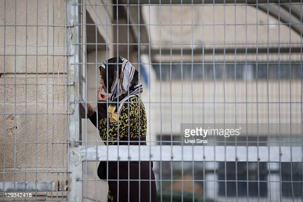 An Israeli Arab woman arrives to visit a relative as Palestinian prisoners prepare to be transported out of Hasharon jail on October 16 2011 in Tel...