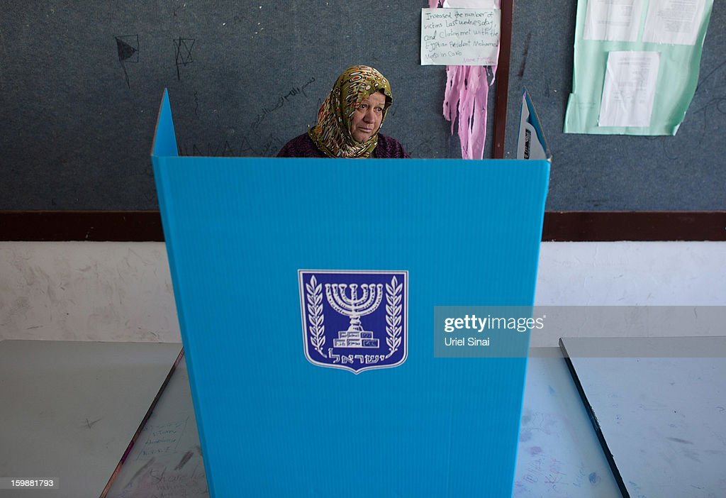 An Israeli Arab woman casts her vote at a polling station during the Israeli General Election on January 22, 2013 in Abu Ghosh, Israel. The latest opinion polls suggest that current Prime Minister Benjamin Netanyahu will return to office, albeit with a reduced majority.