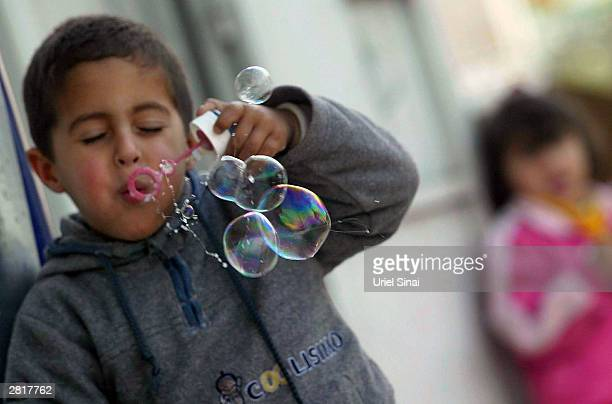 An Israeli Arab youth plays after school December 17 2003 in the town of Tira Israel Finance Minister Benjamin Netanyahu sparked anger from the...