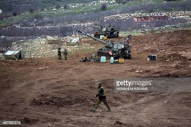 An Israeli army 155mm mobile artillery battery is stationed near the border with Syria in the Israeliannexed Golan Heights on January 28 2015 At...