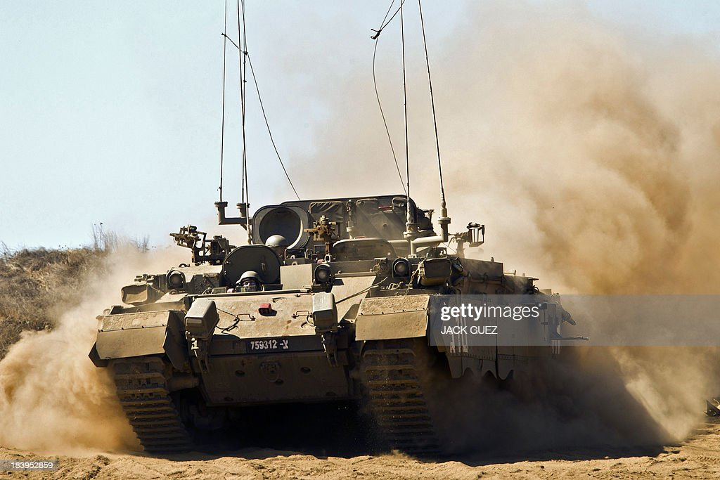 An Israeli army Armoured Personnel Carrier (APC) rolls in a training field in the Golan Heights, next to the Israeli-Syrian border, on October 10, 2013. The Israeli army fired on October 9, a Tammuz missile across the Syrian border in response to mortar fire from the Syrian at an Israeli military base in the northern Israeli-annexed Golan Heights leaving two soldiers with light wounds.