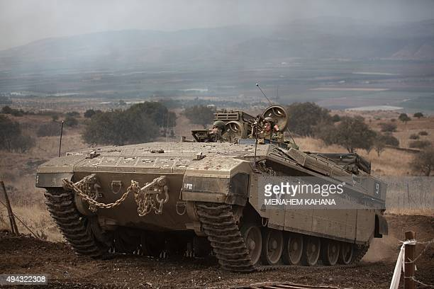 An Israeli army armoured personnnel carrier is seen during an annual military exercise in the center of the Israeliannexed Golan Heights on October...