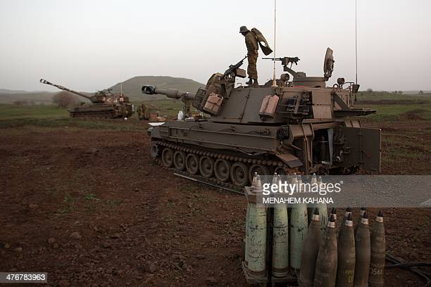An Israeli Army Artillery battery unit is deployed on alert in the occupied Golan Heights on March 5 2014 Israel's army said it struck two Hezbollah...