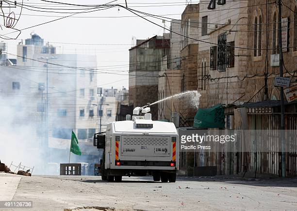An Israeli army jeep sprays Palestinian the streets of Hebron with foul smelling skunk water during a demonstration in the West Bank city of Hebron...
