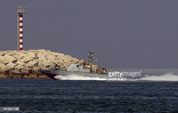 An Israeli army military vessel enters the southern navy port of Ashdod on May 31 as local media said several people were killed when Israeli forces...