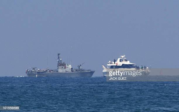 An Israeli army military vessel escorts one of the boats in a Gazabound aid flotilla with Israeli troops on board in the southern Israeli navy port...