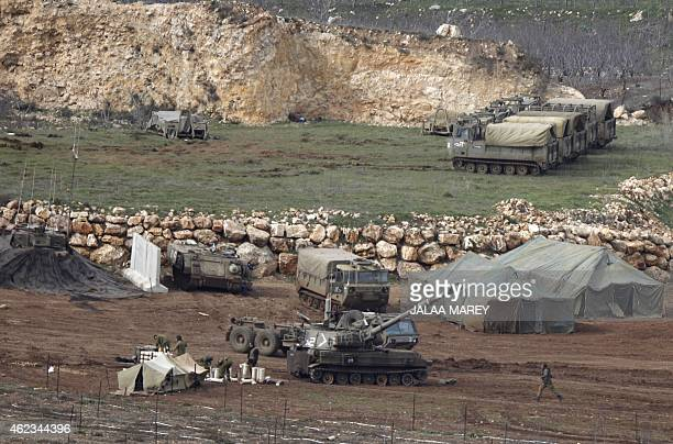 An Israeli army mobile artillery cannon is stationed near the border with Syria in the Israelioccupied Golan Heights on January 27 2015 At least two...