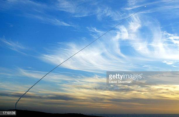 An Israeli Arrow antiballistic missile leaves a smoke trail in the evening sky as it flies towards a target after launching from the Palmachim Air...