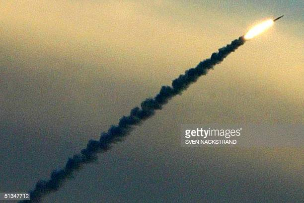 An Israeli Arrow missile soars through the air shortly after its launch in the latest test from the Palmahim air force base south of Tel Aviv 05...