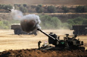 An Israeli artillery gun fires a 155mm shell towards targets from their position near Israel's border with the Gaza Strip on July 30 2014 Israel...