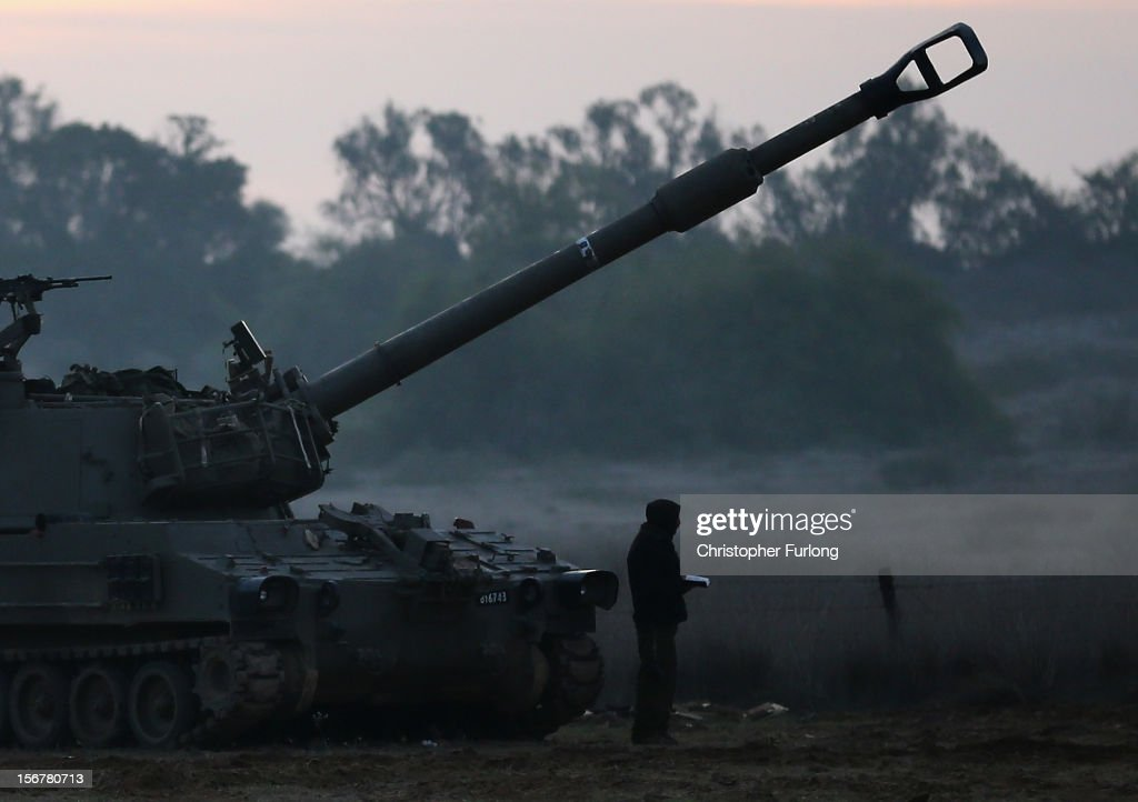 An Israeli artillery gunner prays at sunrise next to his 155mm cannon at an emplacement on November 21, 2012 on Israel's border with the Gaza Strip. Despite widespread rumours of a ceasefire militants in the Gaza Strip continue to fire rockets and Israel continues it's bombardment. US Secretary of State Hillary Clinton has arrived in Israel to support and encourage a peace deal being brokered by Egypt.