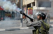 An Israeli border guard fires a tear gas canister during clashes with Palestinian youths over the flashpoint AlAqsa mosque compound on September 21...