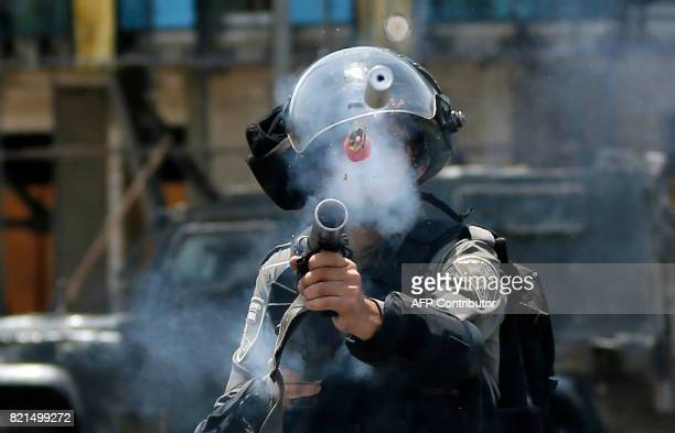 TOPSHOT An Israeli border guard fires a tear gas canister towards Palestinian protesters during clashes near the Jewish settlement of Beit El near...