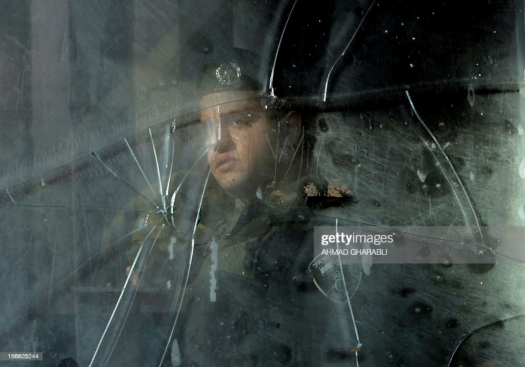 An Israeli border policeman stands inside a police station which was stoned by Palestinian protestors in Salahaddin street, a main commercial area of mostly Arab east Jerusalem, on November 22, 2012. The incident followed the detainment of a Palestinian woman who tried to stab an Israeli border policeman.
