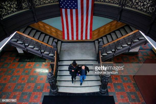 An Israeli born woman exits after she received her US citizenship at a naturalization ceremony at the City Hall of Jersey City in New Jersey on...