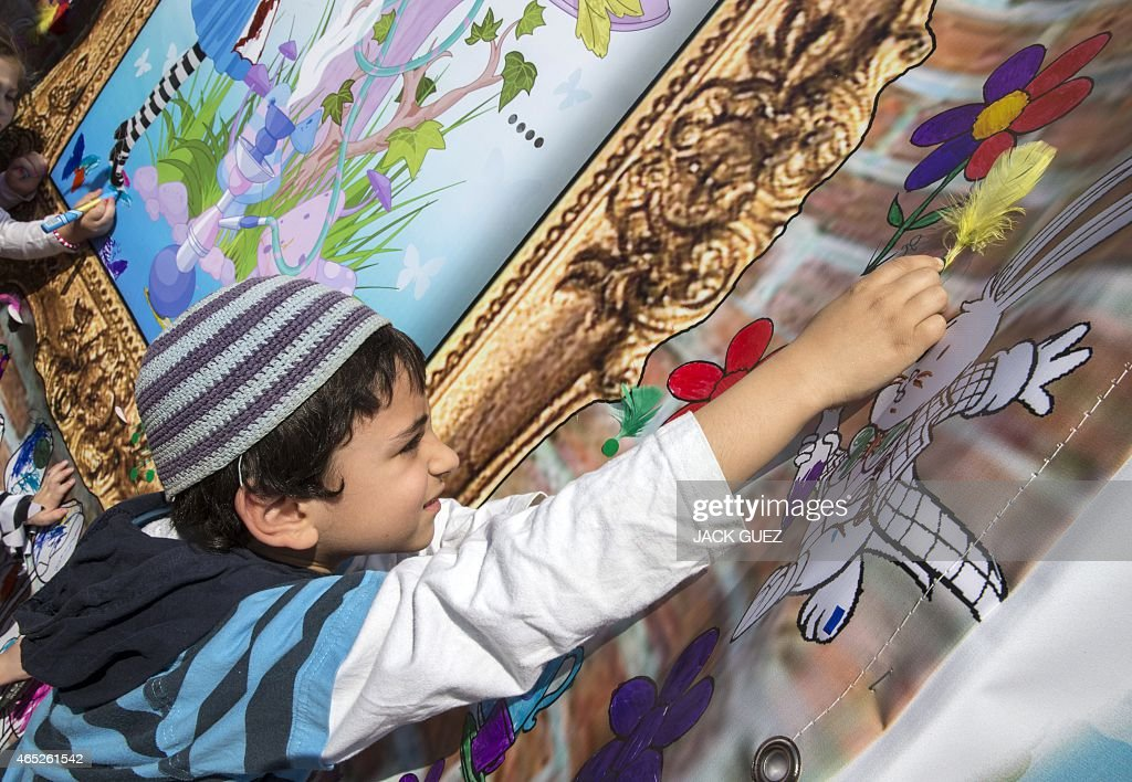 An Israeli boy takes part in activities for children during the festivities of the Jewish Purim festival on March 5 2015 in the central Israeli city...
