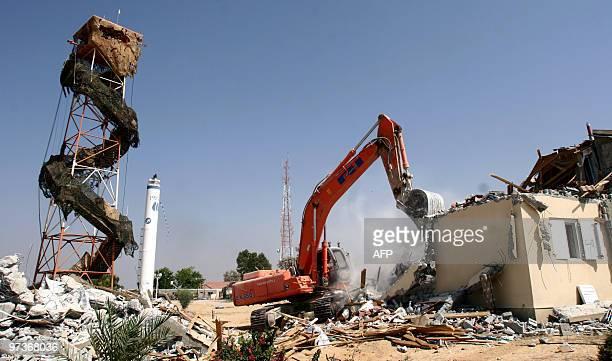 An Israeli bulldozer demolishes houses in the southern Gaza Strip settlement of Morag 22 August 2005While bulldozers were demolishing empty settler...