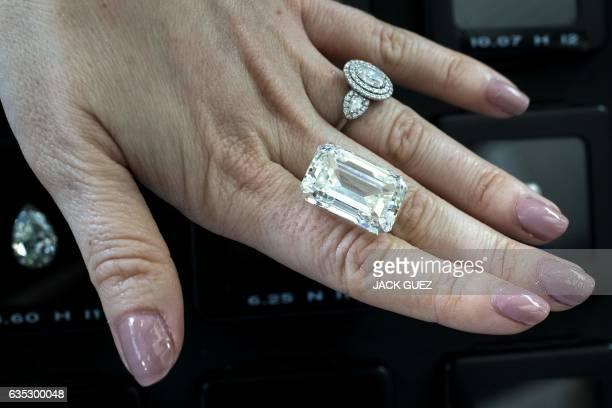 An Israeli buyer checks a 365 carat diamond valued at $15 million during the International Diamond Week in the Israeli city of Ramat Gan east of Tel...