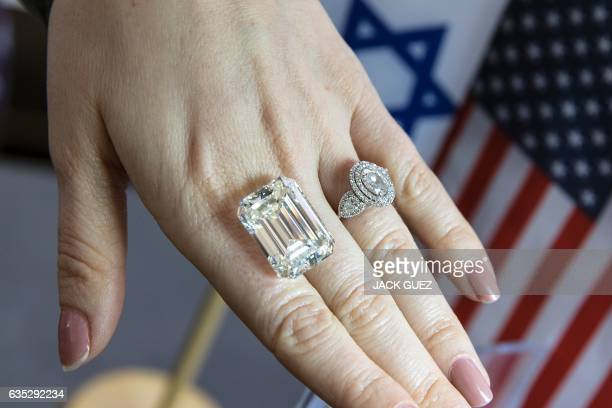 An Israeli buyer checks the quality of a 365 carat diamond valued at $15 million during the International Diamond Week in the Israeli city of Ramat...