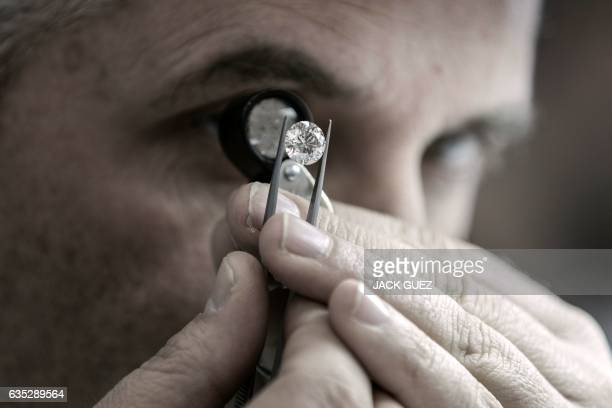 An Israeli buyer checks the quality of a diamond during the International Diamond Week in the Israeli city of Ramat Gan east of Tel Aviv on February...