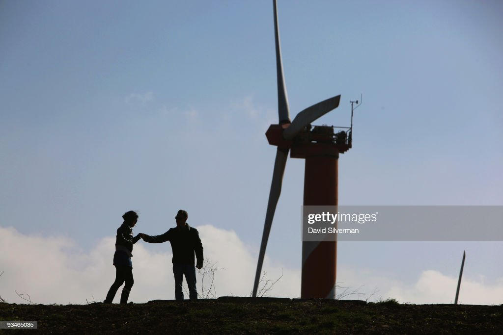 An Israeli couple visits the wind farm on Mount Bnei Rasan overlooking the border with Syria on November 27, 2009 near the Israeli community of Alonei Habashan in the Golan Heights. The ten wind turbines produce 6 megawatts of electricity which is used by local industry and the residents of the disputed plateau which Israel captured from Syria in the 1967 Six Day War. It was built in 1992 and was the first commercial wind-power project in the Middle East. The United Nations Climate Change Conference in Copenhagen, Denmark will take place between December 6-18 with representatives over 160 countries with the objective to prevent global warming and climate changes.