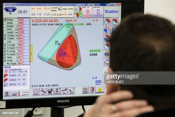 An Israeli diamond buyer evaluates a rough cut diamond in a scanner to analyse the possibilities of transformations and imperfections during the...