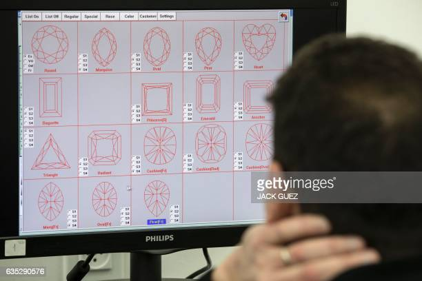 An Israeli diamond buyer evaluates a rough cut diamond in a scanner to analyse the possibilities for transformations and imperfections during the...