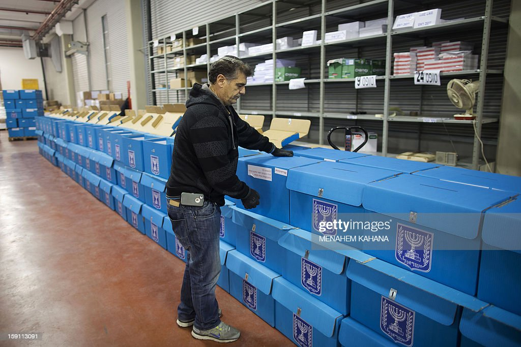 An Israeli electoral worker arranges ballot boxes at the headquarters of the Israeli Elections Committee, near the central Israeli town of Shoham, on January 8, 2013. Israelis will vote in general elections on January 22.