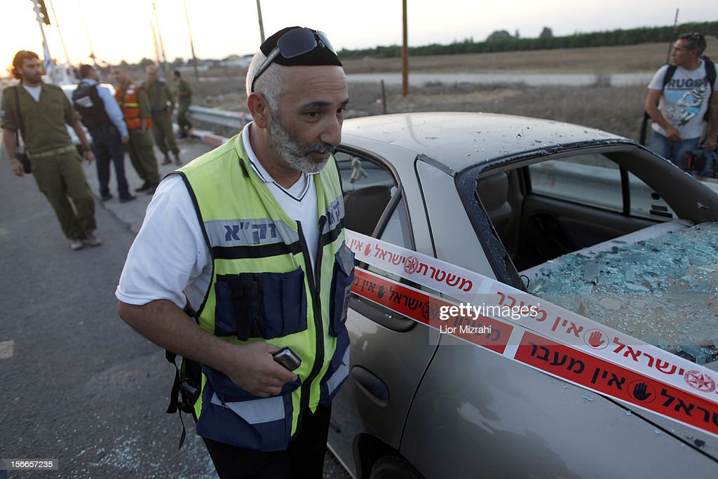 An Israeli emergency personnel inspects the damage to a car that was hit by a rocket fired by Palestinian militants from the Gaza Strip on November 18, 2012 in Ofakim, Israel. Israeli/Gaza attacks have entered the fifth day, with two media buildings being recently struck and several journalists subsequently injured. According to health officials in Gaza, at least 50 Palestinians have been killed since Israel launched operation Pillar of Defence. So far three Israelis have died in the exchange of missiles which followed an air strike on Wednesday that killed Hamas military chief Ahmed Jabari.
