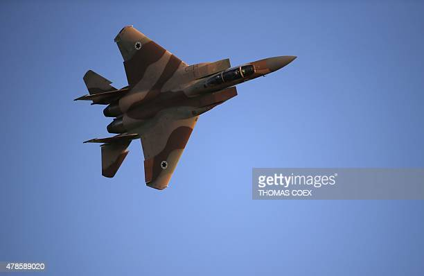 An Israeli F15 E fighter jet performs during an air show as part of a graduation ceremony of Israeli pilots at the Hatzerim air force base in the...