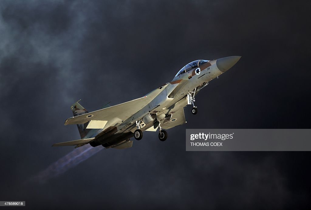 An Israeli F15 E fighter jet takes off during an air show as part of the graduation ceremony of Israeli pilots at the Hatzerim air force base in the...