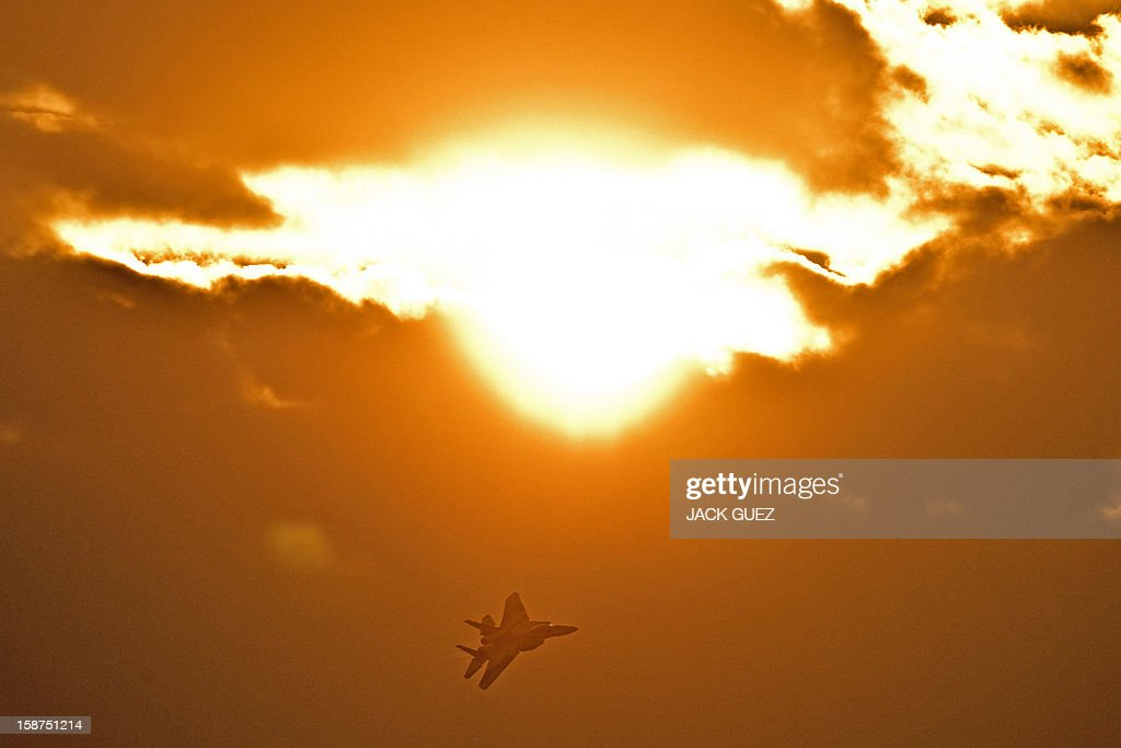 An Israeli F-15 I fighter jet flies during an air show at the graduation ceremony of Israeli pilots at the Hatzerim air force base in the Negev desert, near the southern Israeli city of Beersheva, on December 27, 2012.