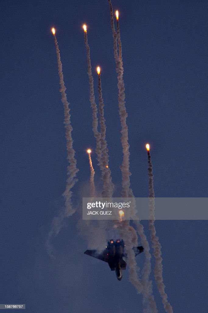 An Israeli F-15 I fighter jet launches anti-missile flares during an air show at the graduation ceremony of Israeli pilots at the Hatzerim air force base in the Negev desert, near the southern Israeli city of Beersheva, on December 27, 2012.