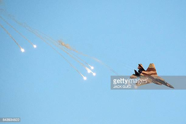 An Israeli F15 I fighter jet launches antimissile flares during an air show at the graduation ceremony of Israeli air force pilots at the Hatzerim...