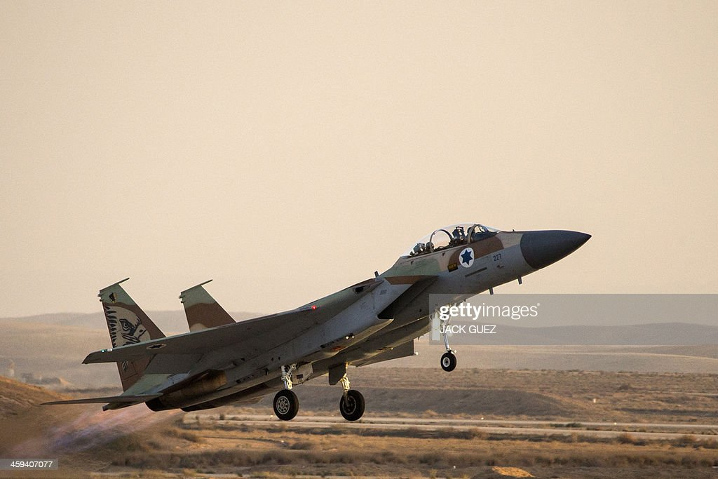 An Israeli F15 I fighter jet takes off during an air show at the graduation ceremony of Israeli air force pilots at the Hatzerim base in the Negev...