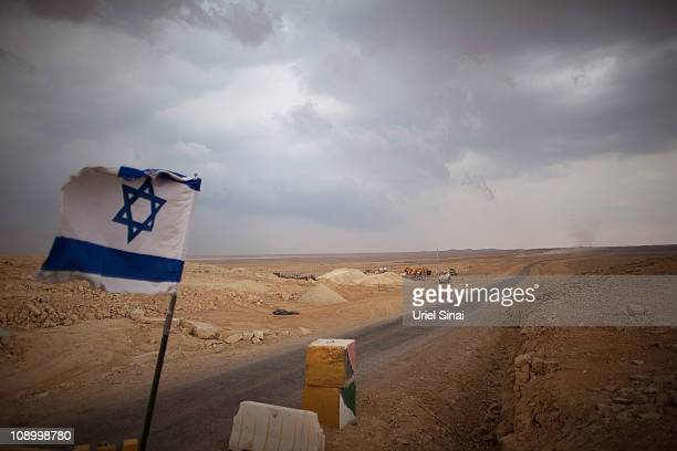 An Israeli flag flies at a checkpoint at the Israeli Egyptian border on February 10 201 in Israel Tensions continues to intensify during the ongoing...
