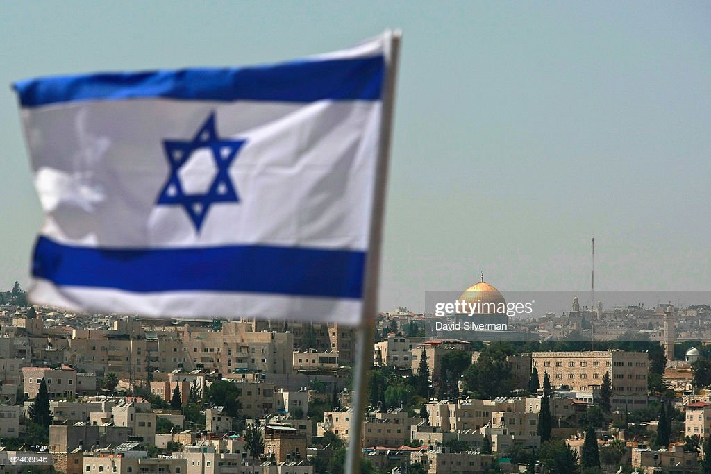 An Israeli flag flies from the Kidmat Zion Jewish settlement community on the outskirts of the Arab village of Abu Dis where the Old City with its...