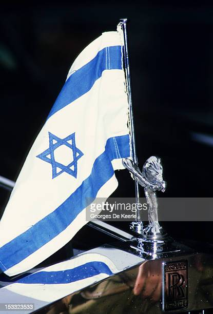An Israeli flag in front of a Rolls Royce car during Shimon Peres visit to London on January 22 1986