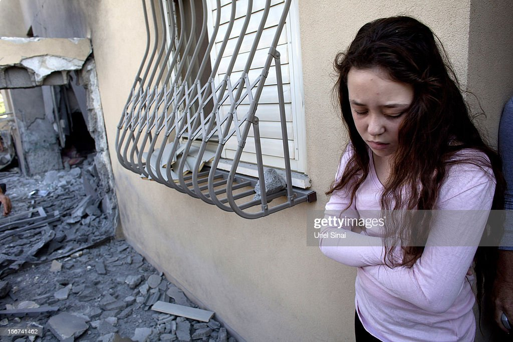 An Israeli girl stands outside her house after it was hit by a rocket fired from the Gaza Strip on November 20, 2012 in Beersheba, Israel. Hamas militants and Israel are continuing talks aimed at a ceasefire as the death toll in Gaza reaches over 100 with three Israelis also having been killed by rockets fired by Palestinian militants.