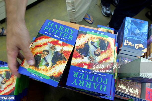 An Israeli Harry Potter fan reaches for JK Rowling's new book 'Harry Potter And The HalfBlood Prince' as it goes on sale July 16 2005 at the Tsomet...