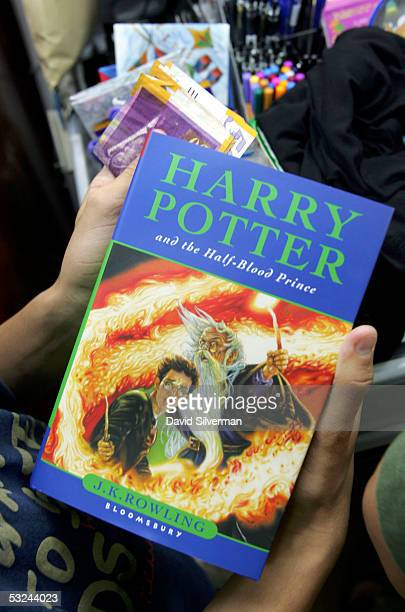 An Israeli Harry Potter fan waits to pay for his copy of JK Rowling's new book 'Harry Potter And The HalfBlood Prince' as it goes on sale at 200 in...