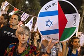 An Israeli leftwing activist holds a banner during a rally demanding fresh IsraeliPalestinian peace talks on the eve of the 20th anniversary of the...