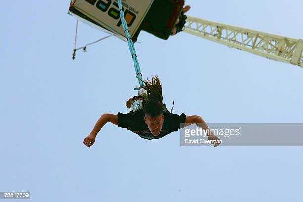 An Israeli man bungee jumps off a crane during the Boombamela new age festival April 5 2007 at Nitzanim beach in southern Israel The threeday...